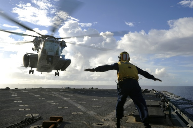 sailor-directing-helicopter-598790